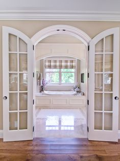 Adorn Your Rooms with Arched French Doors Interior: Breathtaking Custom Interior Arched French Doors With White Bathtub And Loft Window Covering ~ wzfjsh.com Doors Inspiration