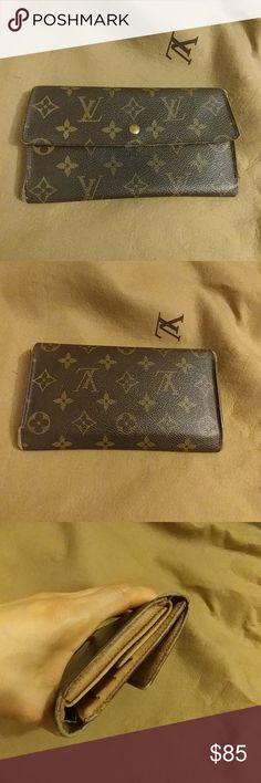 "Louis Vuitton Monogram Iinternational Long Wallet Louis Vuitton Monogram Iinternational Long Wallet Made in France  Date Code: TH1925 (Made in 1995) Canvas is in good condition  Wallet shows significant wear  No stickiness or pweling inside  Fair condition  Shows wear tearing and stains  Corners shows some wear and tearing Please see images for details 7.50""L x 4.40""H x 0.15W Louis Vuitton Bags Wallets"
