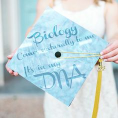 Graduation cap inspiration for biology majors: can you spy Darwin's finches, gel electrophoresis bands, cell culture and a DNA double helix?