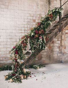 Floral Garland and Candle Lanterns down the Stairs | Albert Bardina Photography | Modern Industrial Fall Wedding