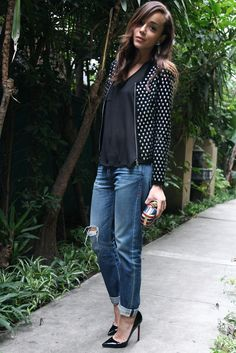 Jeans: Courtesy of Level 99. T.Shirt: Kain.  Shoes: Christian Louboutin 'Pigalle'.  Clutch: Alexander McQueen Jacket: Zara