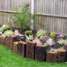 how to build a garden wall with railway sleepers ile ilgili görsel sonucu