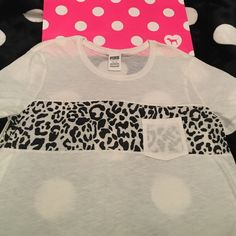 VS PINK Leopard Pocket Tee NWT Medium VS PINK Leopard Pocket Tee. New with tags. Size medium.  See pictures as you will receive as pictured. No  trades. No holds. All offers or (lowest ?'s) please use make offer button only please (reasonable offers).  Thanks for looking & Happy Poshing PINK Victoria's Secret Tops Tees - Short Sleeve