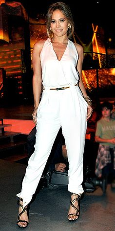 JENNIFER LOPEZ  White-hot in a slim-fitting jumpsuit, metallic accessories and Marina B jewels, the American Idol judge poses before a performance show in Hollywood.