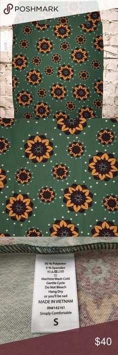 LuLaRoe Cassie LuLaRoe Cassie. Sunflowers 🌻 on a green background! Available in size S! LuLaRoe Skirts Midi