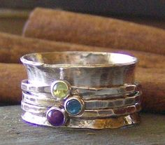 hand stamped Birthstone sterling silver spinner ring mothers ring. $110.00, via Etsy.