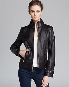 Collared black leather jacket. Women's clothing fashion. Taste. Style. Trends.
