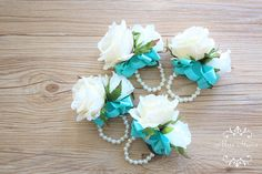 Made to order items The price is for one boutonnieres / corsage. Processing time: 5 working days. Silk Flower Roses in ivory with white hydrangea and white rose. Size: Roses about 8cm The pictures are showing color 18 turqouise ribbon, with pearl cuff stretched bracelet. Type