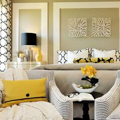 I love the chairs with side table at the end of the bed.  Decorating with Yellow - Right, Now   Wayfair