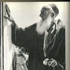 """Moroccan Jew blessing a mezuzah prior to entering a building. Picture taken from """"One People, The Story of the Eastern Jews by Dr. Dvora and Rabbi Menachem Hacohen."""