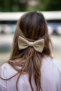 hair pinned back with a bow