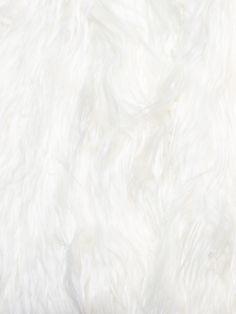 A piece of long pile White fake fur.