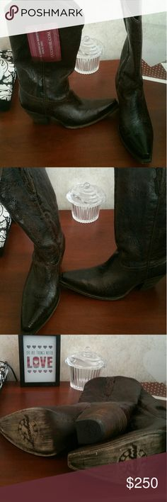 NWT Lucchese cowgirl boots check them out Nwt but not original box. Super sexy snip toe Luchesse ladies cowboy boots. Unique color. Marble look almost dark chocolate/ black tooled leather I believe called black cherry. Textured print. Sure to turn heads. Absolutely stunning and too much detail to photograph. Never worn tried on but never worn out of house. Check out all the pics these are $400 + boots. Great deal. luchesse Shoes