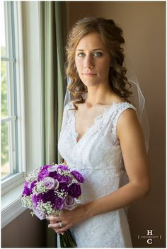 This bouquet was created using lavender roses, lavender carnations, purple carnations and babies breath.  Bouquet was designed by Christine Harned and the photograph was taken by Hannah Cooper photography.