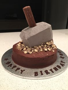 Thor's Mjolnir cake. Base: mud cake with chocolate mousse. Hammer: mud cake with cream cheese icing + Mars bar