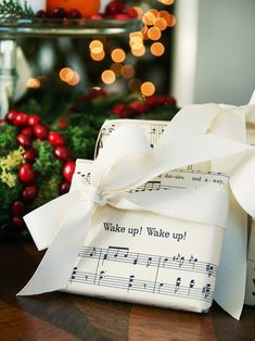 Looking for a classy way to wrap your gifts this year?  For a timeless look, forget store bought wrapping paper. Instead, wrap small gift boxes with vintage holiday sheet music and then add a thick ribbon. You can print out music sheets from Pinterest :)