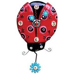 im totally doing my kitchen in ladybugs and someone better get me this clock! haha