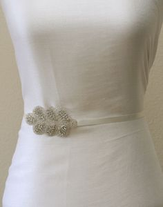 Clear crystal bridal sash, beaded bridal sash, ivory satin tie back sash. $33.00, via Etsy.