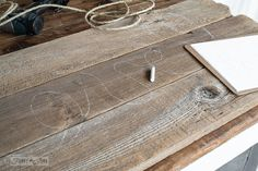 chalking in the design / How to make a reclaimed wood Love rope sign on a headboard / funkyjunkinteriors.net
