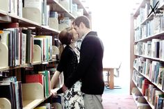 engagement shoot in public library for two bookies