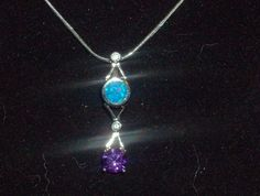 LOOK!!! A STUNNING STAMPED 925 STERLING SILVER BLUE FIRE OPAL AND AMETHYST NECKLACE