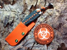 "Zombie Hunter L.D.K.  ""Last Ditch Knife""  EnZo Necker 70 /F: Hunter Green Paracord with glow in dark stripe, Signal Orange Paracord, polished titanium bead, glow in dark cord lock.  Signal Orange Kydex sheath, anodized Chicago Screws with glow in dark dots."
