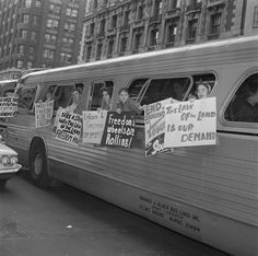 Freedom Riders hang posters from a bus during one of the trips the group took in 1961 in an effort to end Jim Crow laws. Freedom Riders, Democracy Now, Forms Of Communication, Jim Crow, Us History, History Major, Civil Rights Movement, African American History, Black History Month