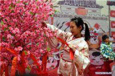 In pics: folk custom festival in Qingdao, E China's Shandong