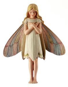 Snowdrop Fairy $13.46 She is part of the Cicely Mary Barker Collection and comes with a 6-inch wire stake making her perfect for planting in your faerie garden.