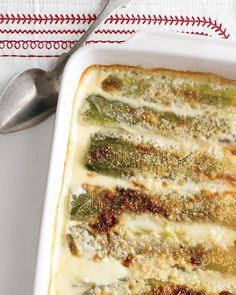 Leek Gratin - Martha Stewart Recipes- made my own version combining this recipe with Jacques Pepin's, but you can't go wrong with heavy cream and cheese!