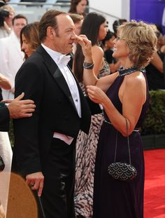 Pin for Later: Relive the Best Moments From the 2014 Emmys  Kevin Spacey got a touch-up on the carpet.