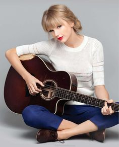 Love this pic of Taylor!! It's so simple yet adorable and I love that her guitar is in there!!