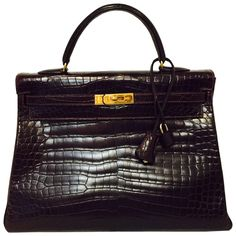 RARE Hermes Kelly 35 Bordeaux Matte Porosus Croc GHW Excellent Condtn | From a collection of rare vintage top handle bags at https://www.1stdibs.com/fashion/handbags-purses-bags/top-handle-bags/