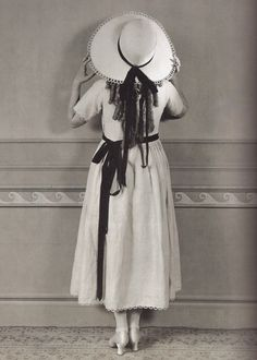Mary Pickford standing with her back to the camera, 1920.