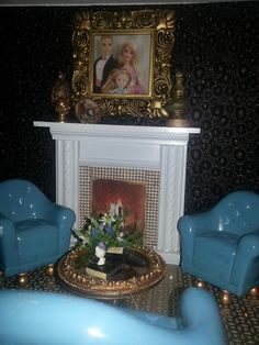 Custom designed Barbie house!  Living room features a fireplace with Barbie's family picture above!
