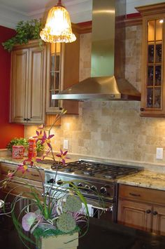 Stained maple cabinets with a chocolate glaze. Absolute black granite provides a strong contrast to the perimeter granite that has a lot of movement.  The natural travertine backsplash plays off the neutrals in the granite.