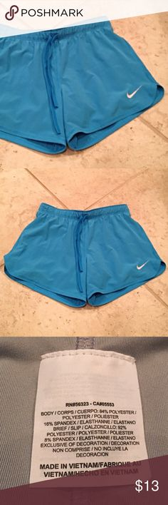 Nike Shorts Light blue Nike shorts with drawstring. Compression shorts built in on inside. Nike Shorts