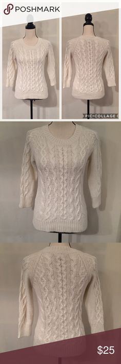 """J. Crew cream cable knit fisherman sweater EUC. No stains or holes. Minimal pilling. J. Crew """"fisherman"""" sweater in vintage champagne, a cream color. 3/4 raglan sleeves. Cables down front, back, and sleeves. Seed stitch on sides. Rib trim at cuffs, crew neckline, and hem. Shorter silhouette. Hits at hip. 45% acrylic, 37% superfine alpaca, 18% Merino wool. Measurements (flat): bust 16"""", waist 15"""", length 25"""". Style 48675. Dry clean. No trades. J. Crew Sweaters Crew & Scoop Necks"""