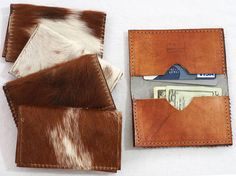 Slim style credit card and business card holder. Outside is made with a hair-on cowhide and the inside is made from veg tan leather and has two pockets that hold multiple cards.  Measures 2 1/2 inches (6 cm) by 4 inches (10 cm) when folded. When open, measures 5 inches (12 1/2 cm)  Please choose one : white, tan, dark multi, or tan multi