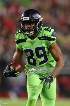 Wide receiver Doug Baldwin #89 of the Seattle Seahawks runs with the football after a reception against the Arizona Cardinals during the first half of the NFL game at the University of Phoenix Stadium on November 9, 2017 in Glendale, Arizona.