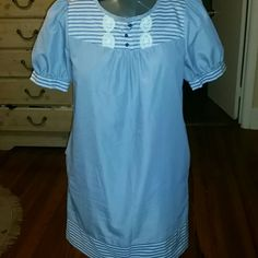 TIBI dress A cotton small pinstripe on the dress and larger stripes on collar, sleeves and the bottom dress by Tibi. It has 3 buttons and crochet lace on the collar area. It also has pockets Tibi Dresses Midi