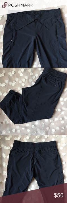Athleta navy cropped ankle joggers  2P Amazing quality joggers from athleta. Made of 86% recycled polyester and 14% spandex. In a lovely dark navy blue, elastic waist band with draw strings and 4 zippered pockets. I am 5'1 and these hit just above my ankle bone. In perfect preloved condition from a smoke free home. Size 2 petite. Athleta Pants Track Pants & Joggers