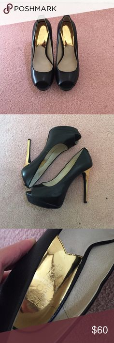 MICHAEL MICHAEL KORS PEEP TOE PUMPS MICHAEL MICHAEL KORS PEEP TOE PUMPS. Worn once, in excellent condition. About 4 1/2 inches heel height, semi hidden platform about 1 1/2 inches. Will not come with box. NO TRADES NO LOWBALLERS MICHAEL Michael Kors Shoes Heels