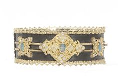 Old World Midnight huggie bracelet with yellow-gold scalloped edges with oval opals and white diamonds.