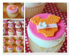Baby shower cupcakes with fondant onesie toppers.