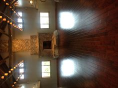 Fireplace shows stone to ceiling and wood floor