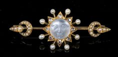 Unusual Victorian moonstone diamond and seed pearl bar brooch with central carved moonstone depicting the face of the man-in-the-moon surrou...