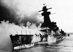 34 The German pocket battleship Admiral Graf Spee, in flames off Montevideo, Uruguay on December 19, 1939. The crew of the Admiral Graf Spee had just engaged in the Battle of the River Plate, after three Royal Navy cruisers hunted it down and attacked. The damage from the attack did not sink the German battleship, but sent it to a harbor in Montevideo for repairs. Unable to stay long enough for repairs, and unwilling to run a waiting blockade, the crew of the Admiral Graf Spee sailed a short…