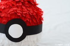 Close up of a homemade Pokeball pinata from And Next Comes L