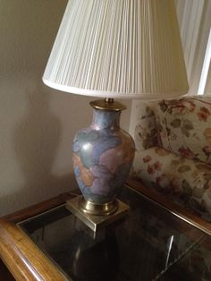 Ceramic lamp with brass base from the late 60's.  Works perfectly. Needs new shade.